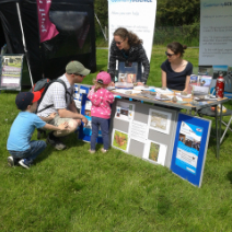 visitors learning about bogs with the moors for the future partnership at Edale Country Day