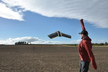 Picture of the unmanned aerial vehicle taking flight over a field