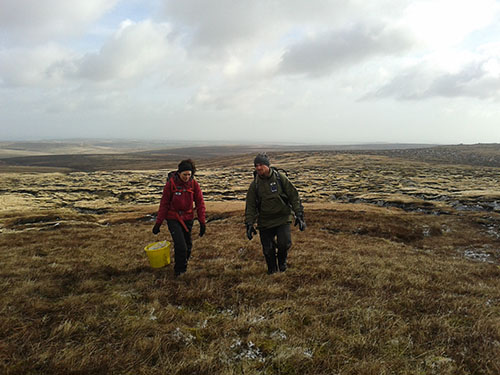 Two workers at Bleaklow