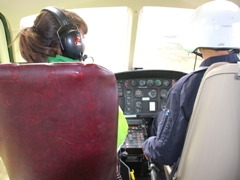 Leah Gooding from newsround in a helicopter