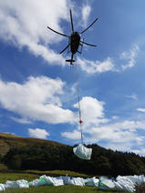 Image of a helicopter airlifting MoorLIFE 2020 projects