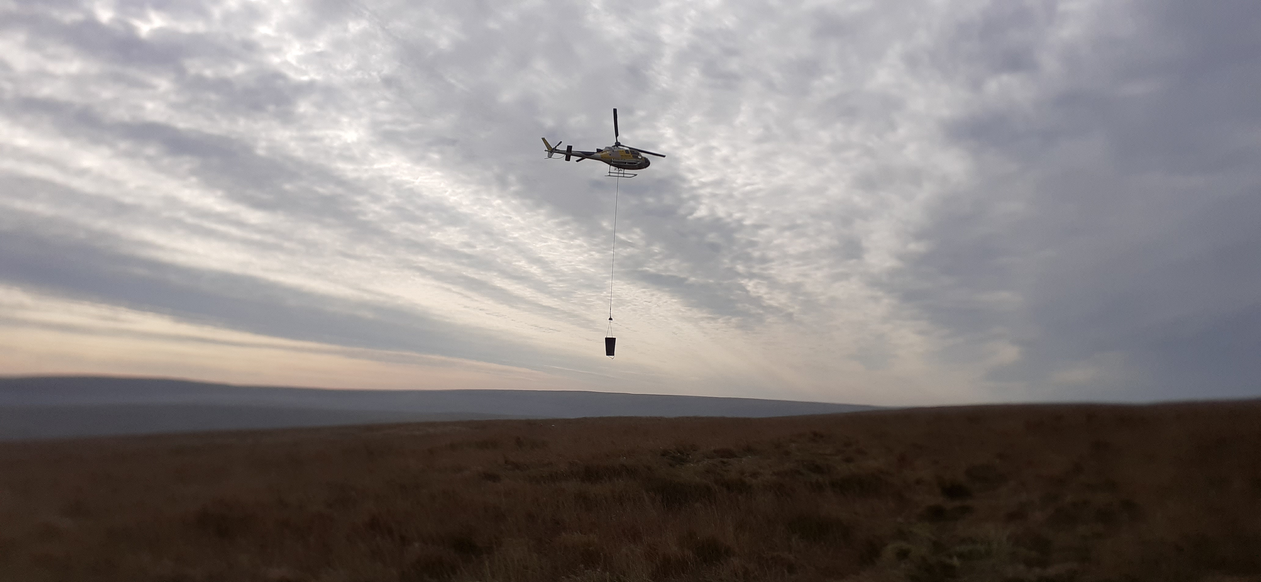 Helicopter flying materials at Close Moss