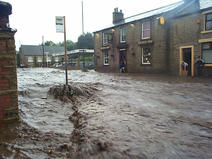 Image of high street west in Glossop flooded