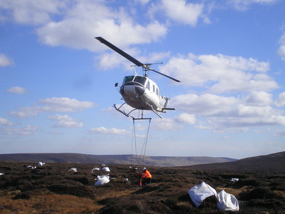 Helicopter and bags of heather brash