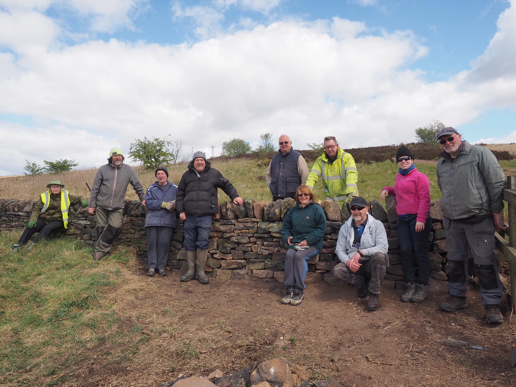 Volunteers with newly built dry stone wall