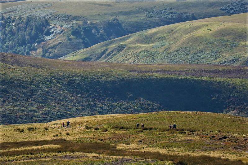 People walking in vast landscape