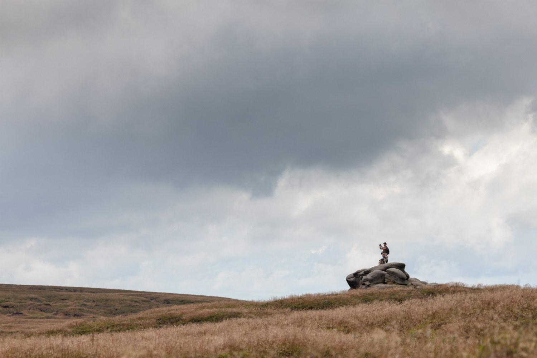 Walker stood atop a large rock at Bleaklow