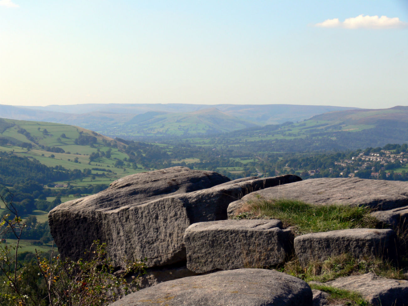 Rocks framing a view of rolling hills of the moorland