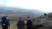 Three research and monitoring officers on top of the moors
